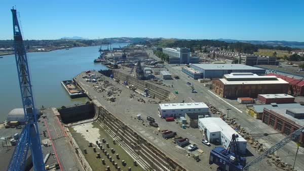 Aerial over an old abandoned shipyard at Mare Island, California. Royalty-free stock video