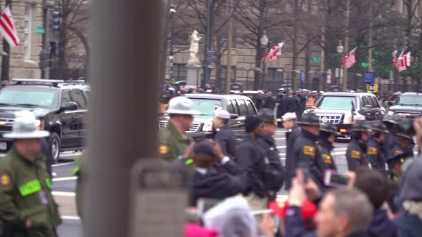 Donald Trump's presidential motorcade moves through Washington DC. Royalty-free stock video