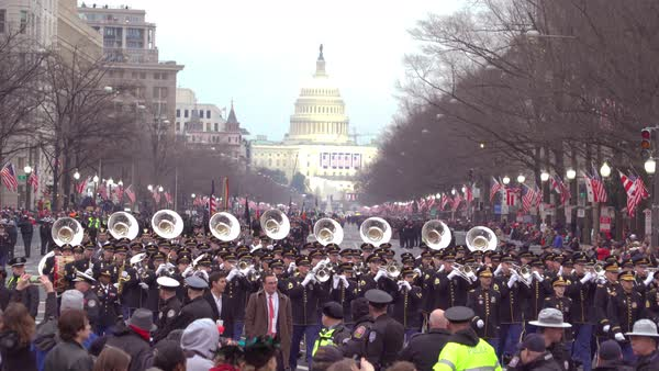 The Marine Corps marching band walks through Washington DC during the presidential inauguration. Royalty-free stock video