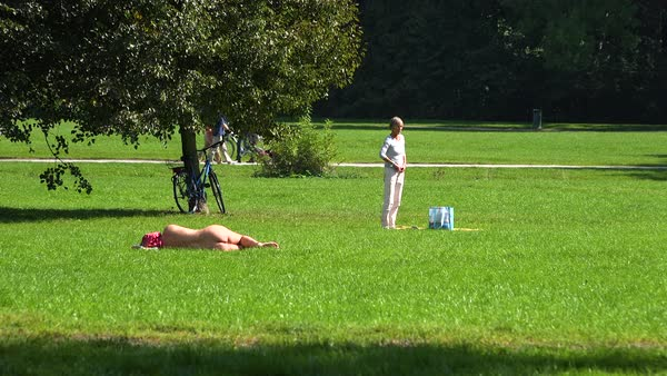 People Sunbathe Naked In English Garden In Central Munich, Germany - Stock Video -2166