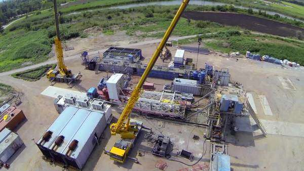 Aerial shot over the oil well in construction Royalty-free stock video