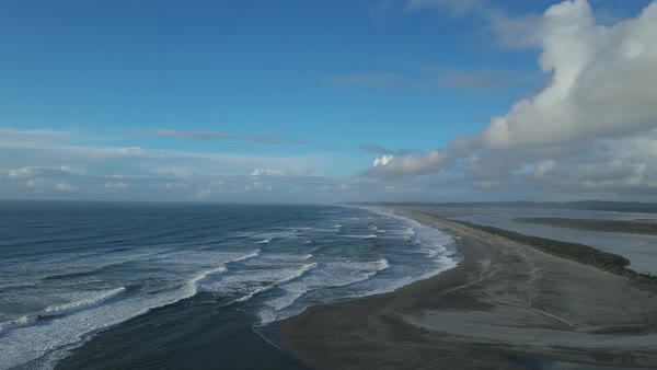 Drone shot of waves rolling onto a beach in New Zealand Royalty-free stock video