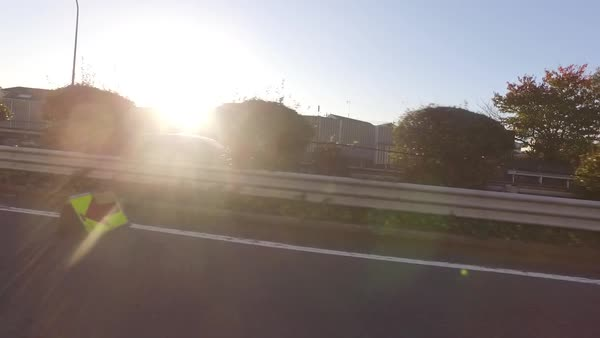 Driving along street during sunset Royalty-free stock video