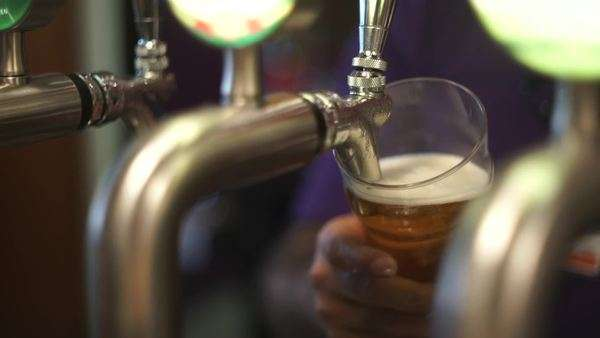 Close-up shot of bartender tapping beer Royalty-free stock video
