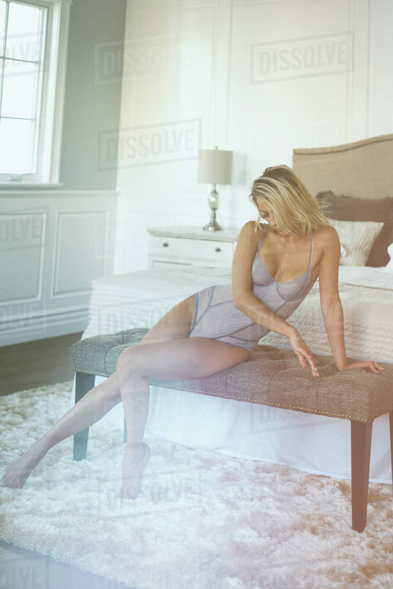 Woman sitting in bedroom Royalty-free stock photo