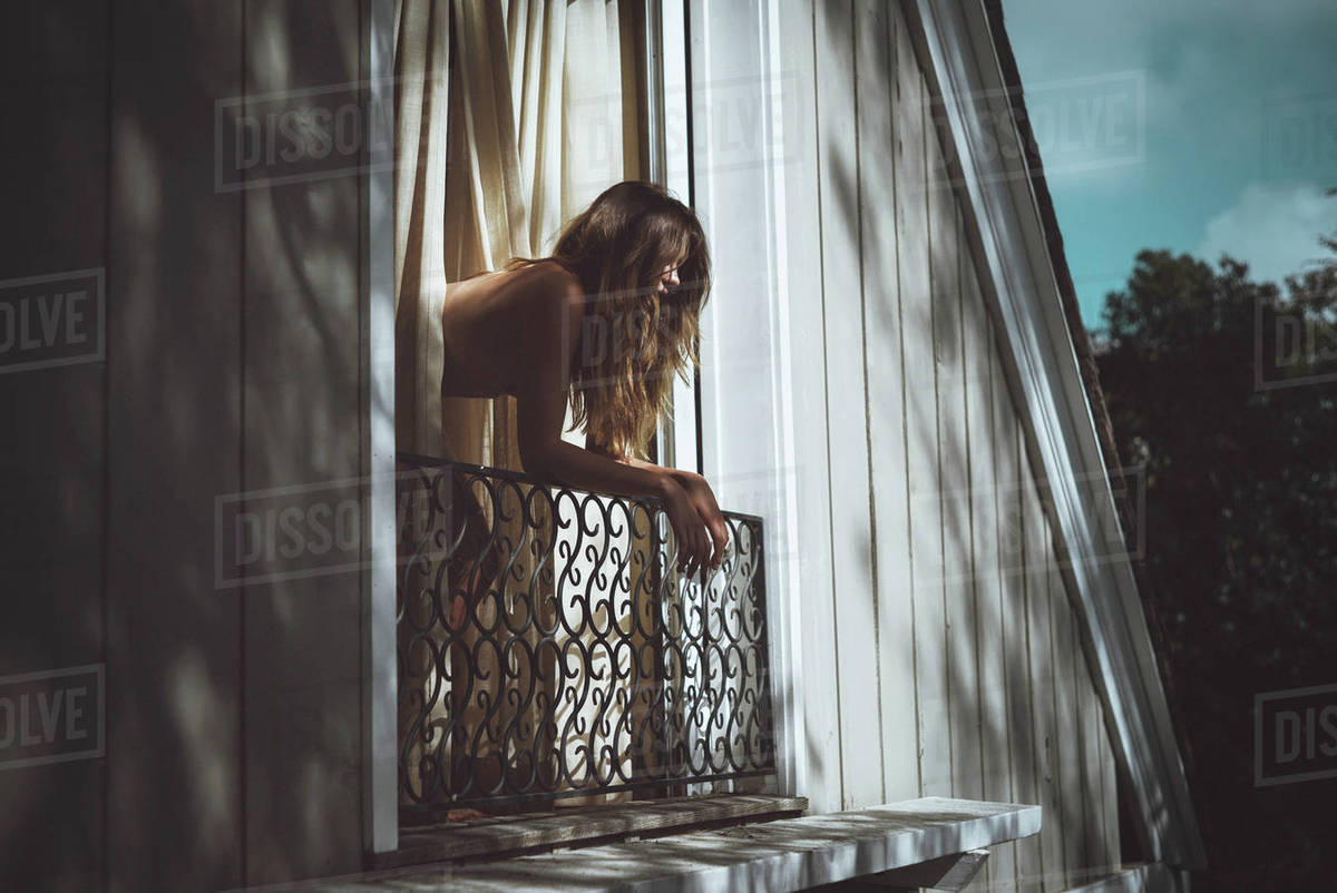 Beautiful young woman leaning on a railing Royalty-free stock photo