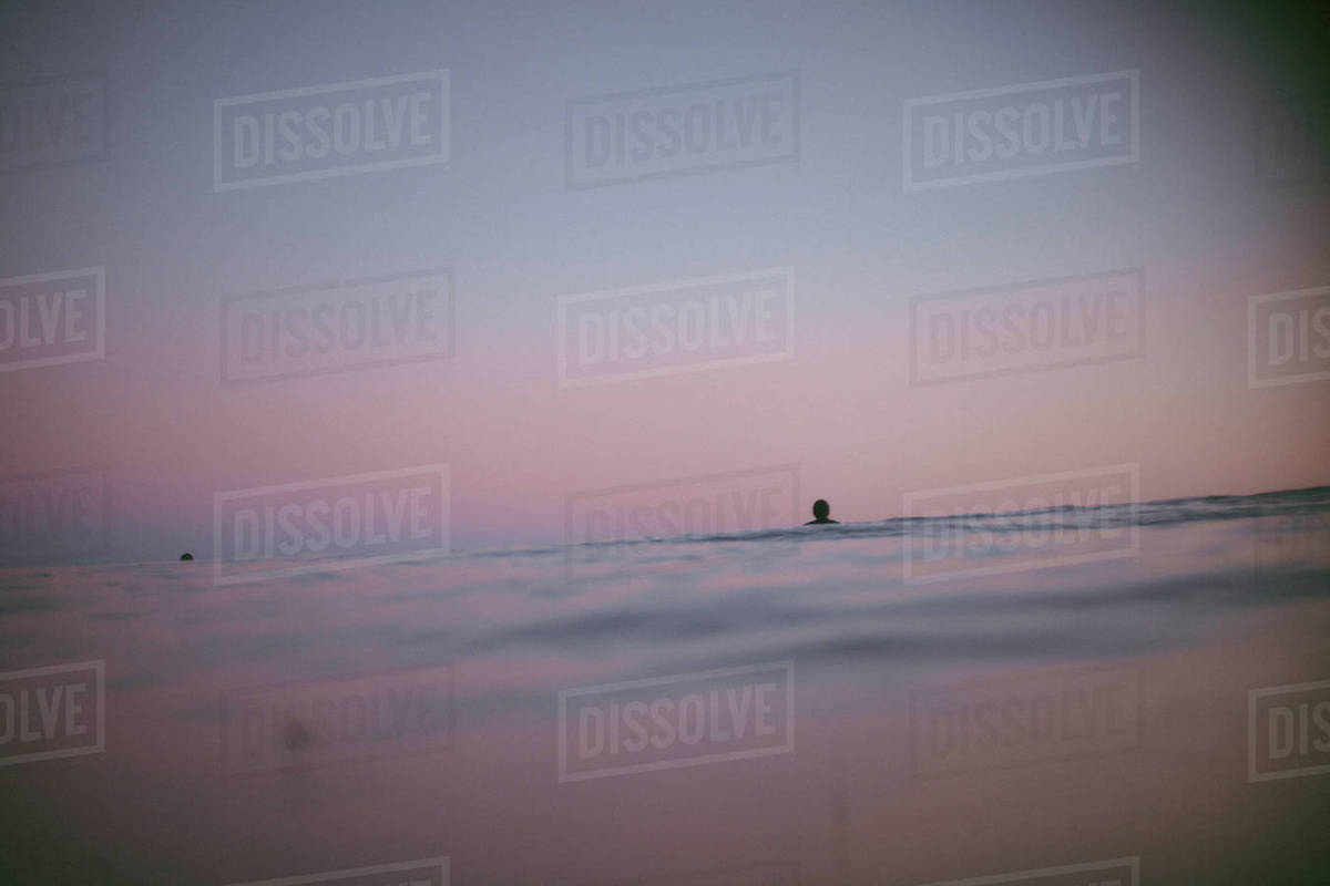 People in ocean at sunset Royalty-free stock photo