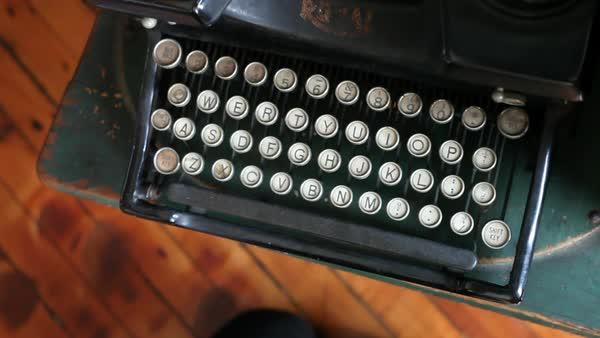 Close-up shot of female hand typing on vintage typewriter Royalty-free stock video