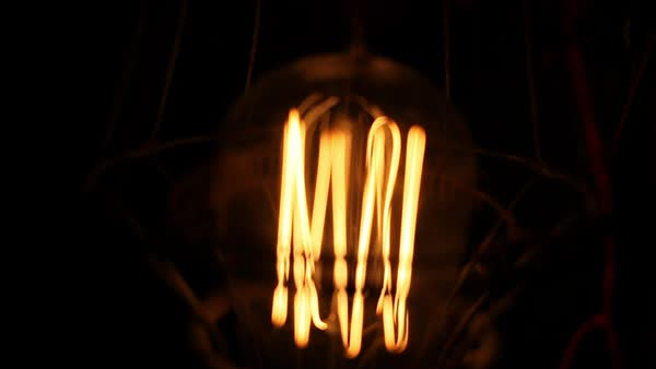 Close-up shot of a lightbulb illumination effects Royalty-free stock video