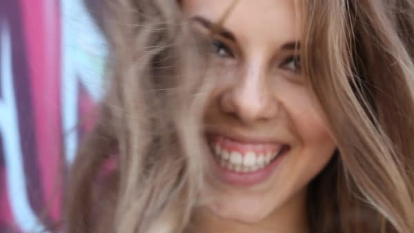 Close-up shot of woman laughing and playing with hair Royalty-free stock video
