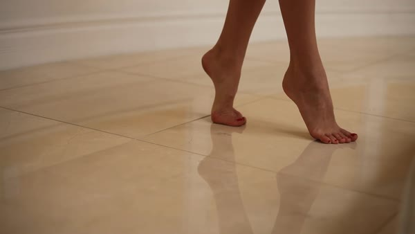 Close-up shot of woman in revealing negligee standing on tiptoes Royalty-free stock video