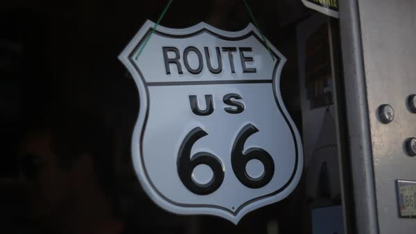 Handheld shot showing a miniature signboard of Route 66 Royalty-free stock video