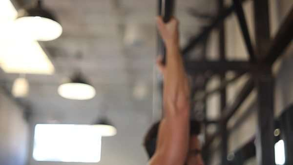 Handheld shot showing a man working out at the gym Royalty-free stock video
