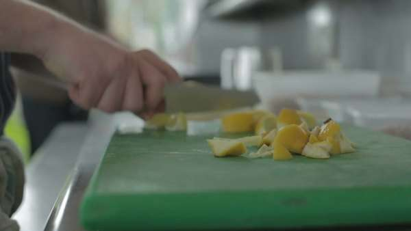 Chef in a kichen slicing a lemon Royalty-free stock video