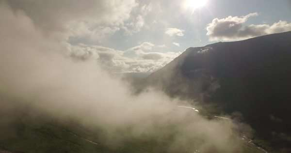 Stunning aerial shot of Glen Etive flying through low cloud revealing natures landscape in the Scottish highlands Royalty-free stock video