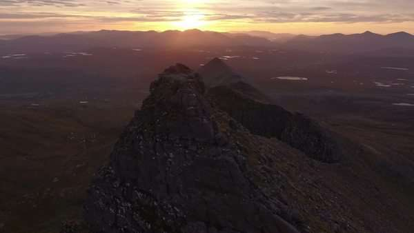 Dramatic aerial shot of An Teallach near Ullapool in the Scottish highlands during sunrise  Royalty-free stock video