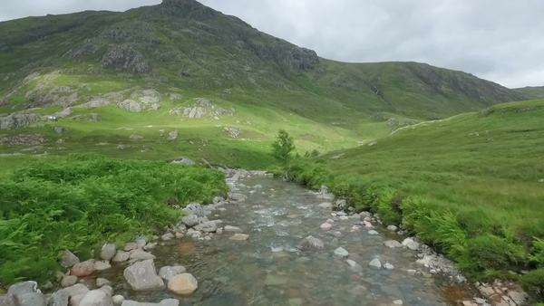 Dramatic aerial shot in Glencoe along a river in the Scottish highlands Royalty-free stock video