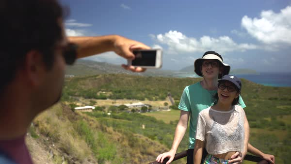 Hand-held shot of a man taking a photo of a couple Royalty-free stock video