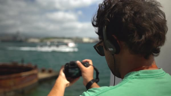 Hand-held shot of a man making a video of a boat Royalty-free stock video