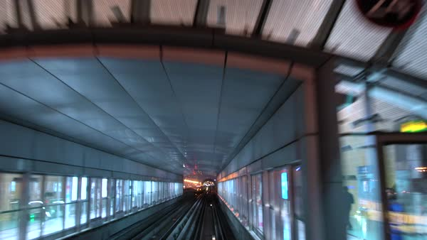 Overhead metro train approaching station, Dubai. Royalty-free stock video
