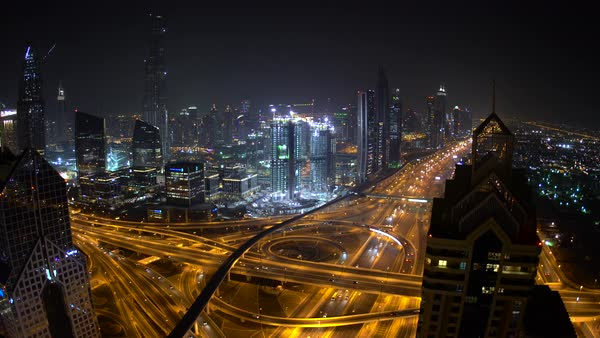 View looking down Sheikh Zayed Road with skyscrapers at dusk, Dubai. Royalty-free stock video