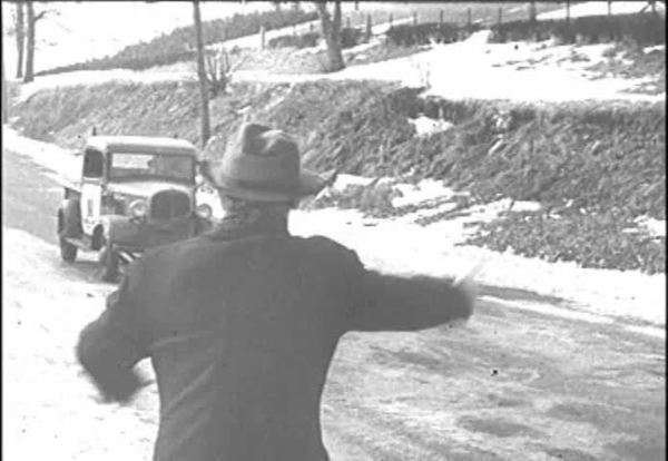 Two undercover Nazi agents hitchhike and are picked up by an Italian-American man who is running for Sheriff in 1944. Royalty-free stock video