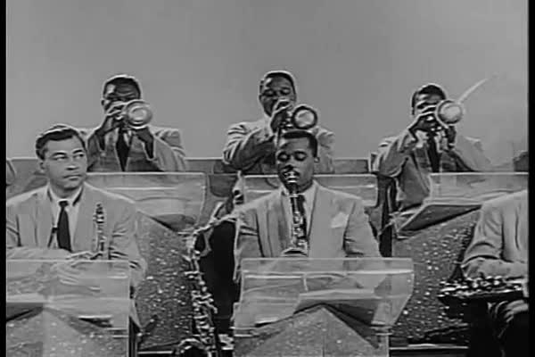 Duke Ellington and his band perform on the Harlem Variety Revue in 1955, NYC, featuring a wispy clarinet solo. Royalty-free stock video