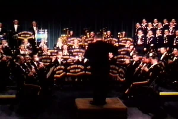 "The US Navy Band and Sea Chanters perform a medley of ""Yankee Doodle Dandy"" and ""Hail, Columbia"" in 1968. Royalty-free stock video"