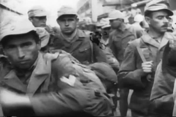 Prisoners of war are rounded up, and Italians celebrate, as Sicily is liberated from the Nazis in WWII. Royalty-free stock video