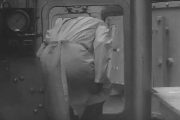 A test subject in a pressure chamber experiences conditions similar to flying a biplane, in 1943. Royalty-free stock video