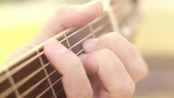 Close-up view of fingers on guitar fretboard Royalty-free stock video