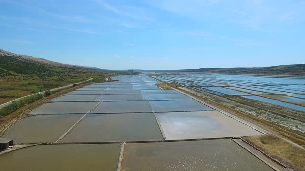 Flying above traditional salt evaporation ponds on Pag island, Croatia Royalty-free stock video