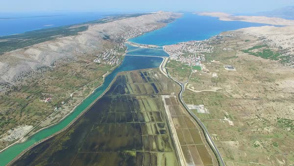 Aerial view of salt pans surrounded by sea and mountains of Pag island, Croatia Royalty-free stock video