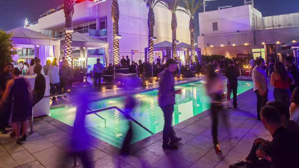 Hyperlapse of a rooftop pool party in Los Angeles, California, USA Rights-managed stock video