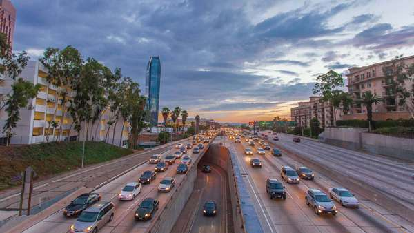 110 FREEWAY, DOWNTOWN, LOS ANGELES, CALIFORNIA, USA - 8 SEPTEMBER 2014, Freeway traffic in a big city on the sunset. Hyperlapse (Timelapse in motion) video view. Transition from day to night. Royalty-free stock video
