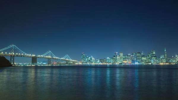 Timelapse of San Francisco skyline and Oakland Bay Bridge at night. Royalty-free stock video