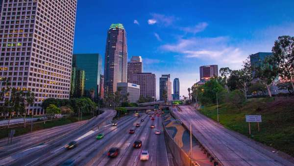 Sunset over city freeway traffic in downtown Los Angeles. Timelapse in motion(hyperlapse). Transition from day to night. Royalty-free stock video