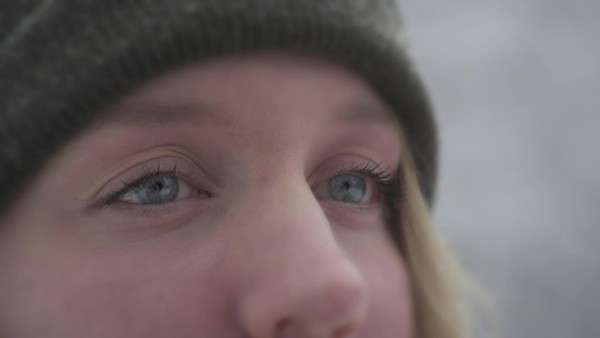Close up on girl's eyes in slow motion as snow falls Royalty-free stock video
