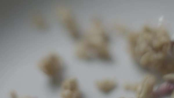 Granola dropping into bowl in slow motion Royalty-free stock video