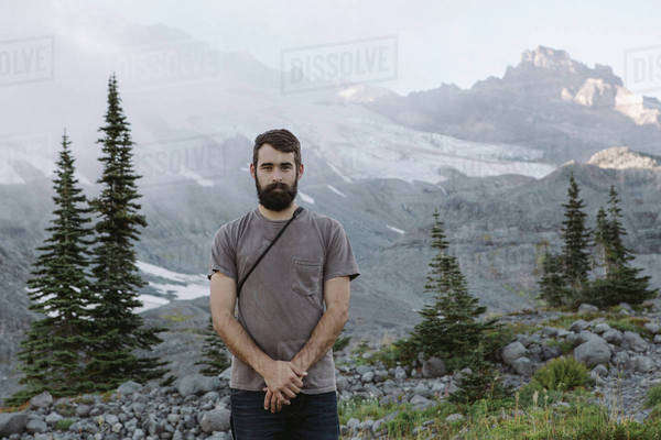 Man stands in front of foggy mountainside Royalty-free stock photo