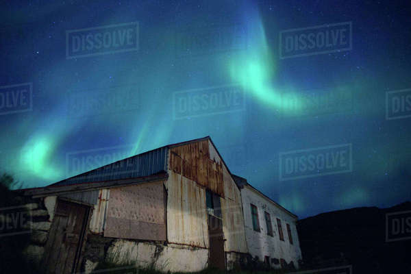 Northern Lights behind old barn Royalty-free stock photo