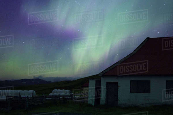 Barn in front of northern lights Royalty-free stock photo