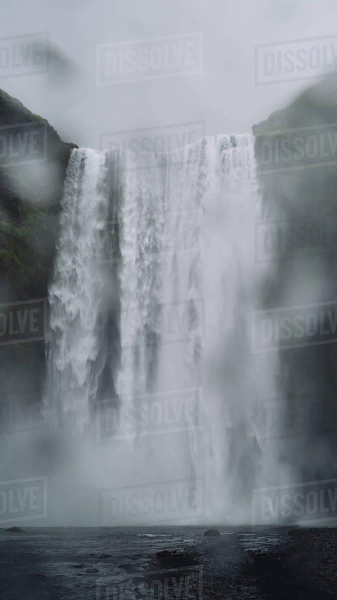 Droplets on lens in front of Skogafoss waterfall Royalty-free stock photo