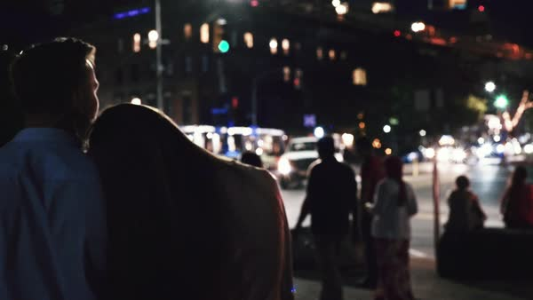 Tracking shot of a couple walking in a street at night Royalty-free stock video