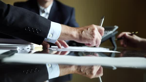 Hand-held shot of businessman handing over a document Royalty-free stock video