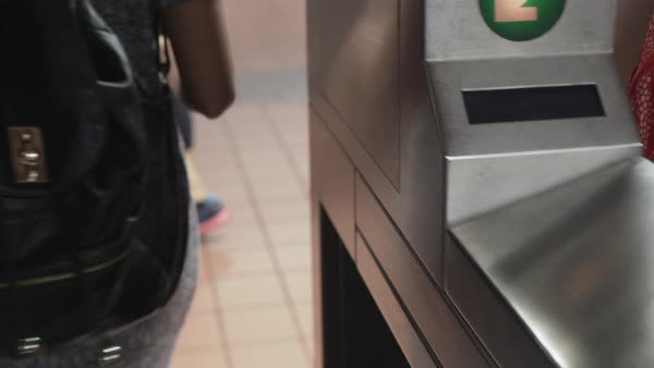 Gimbal shot of a woman passing through a turnstile with a card Royalty-free stock video