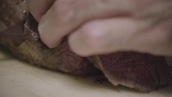 Hand-held shot of a chef slicing meat Royalty-free stock video