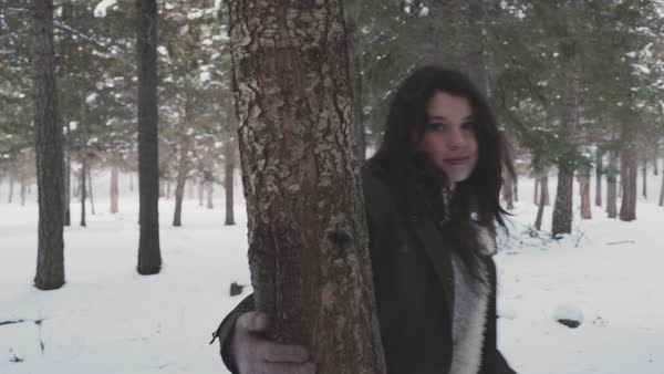 Tracking shot of a young woman walking in a winter forest Royalty-free stock video