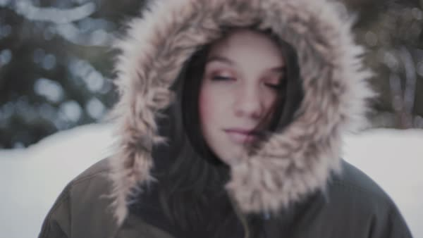 Push-in shot of a beautiful young woman in a winter forest Royalty-free stock video
