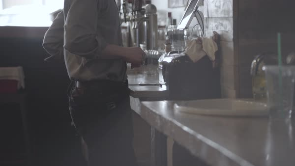 Hand-held shot view of a waiter printing the bill for customers Royalty-free stock video